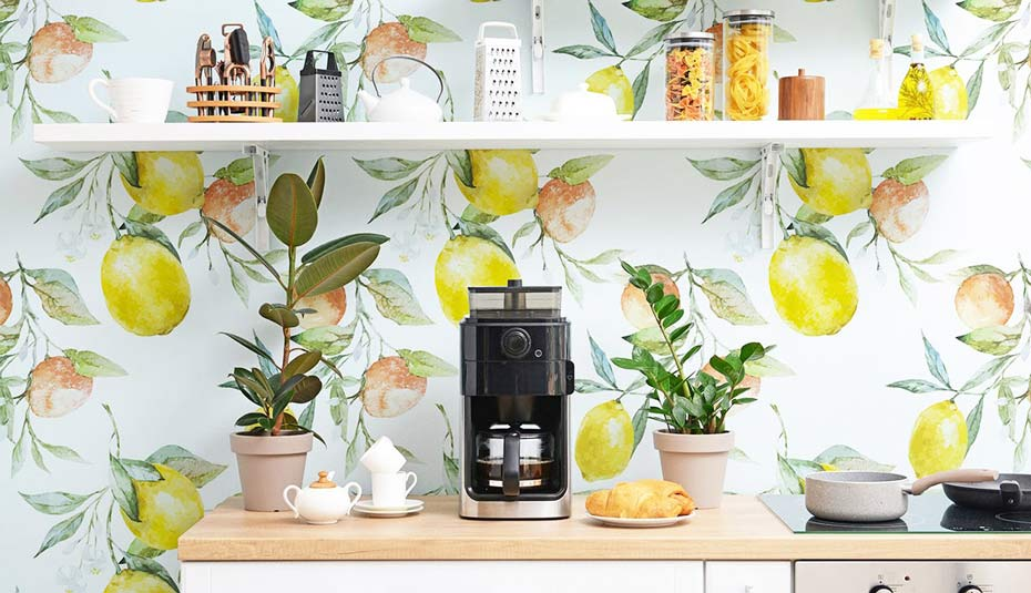 A home coffee bar decorated with citrus peel and stick wallpaper.