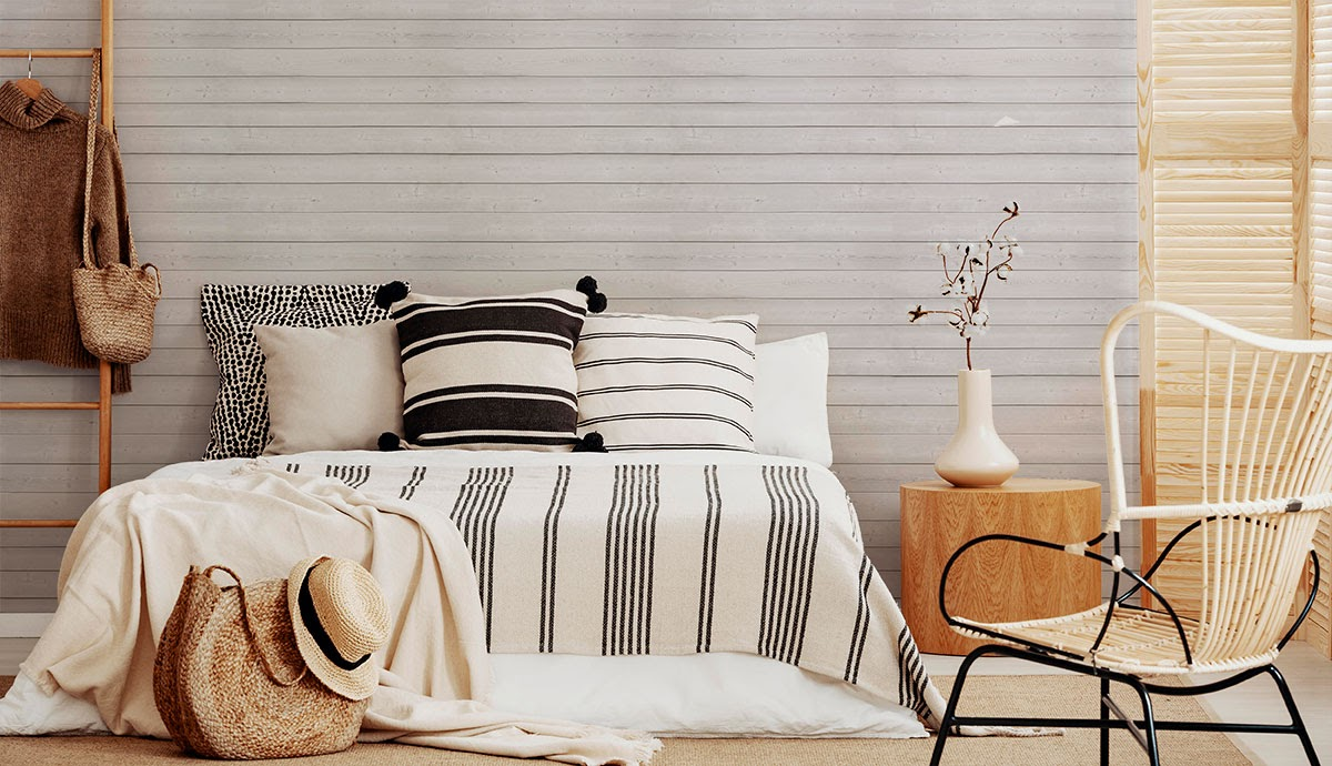 Cool natural tones create a simple bedroom aesthetic.