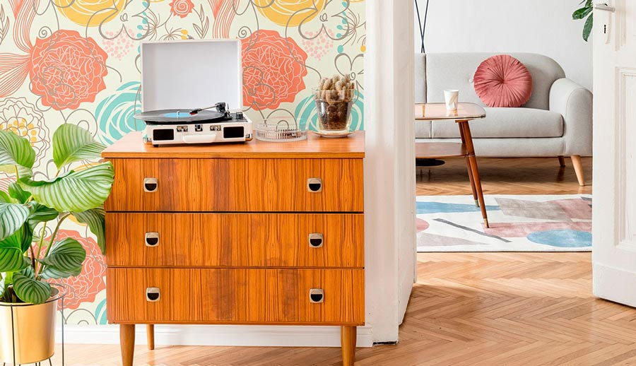 A dresser with a vinyl record player.