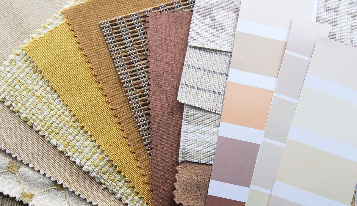 A selection of fabric samples and paint cards