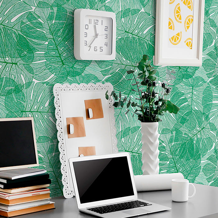 laptop on table with White and Green Botanical wallpaper