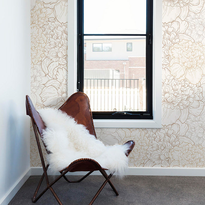 window area with two-toned beige colored flowers with metallic accents wallpaper