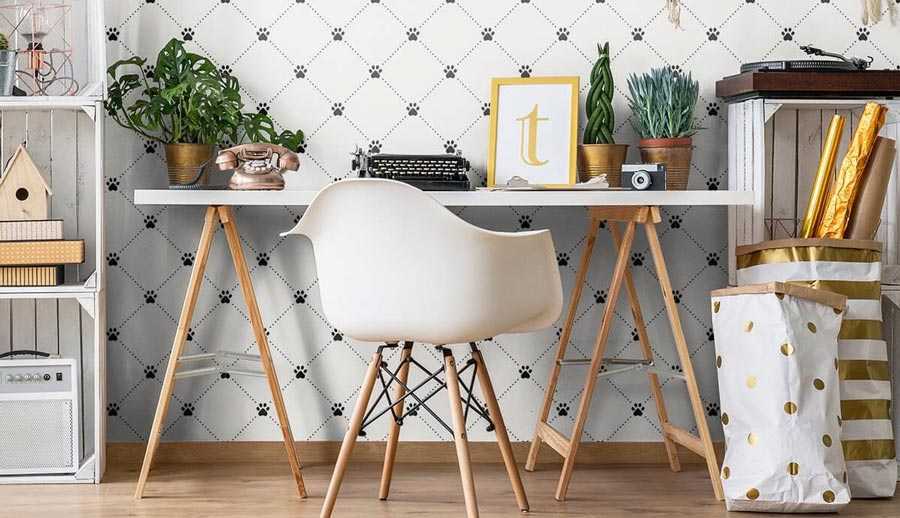 Geometric paw print dog themed room decor in a writing space.