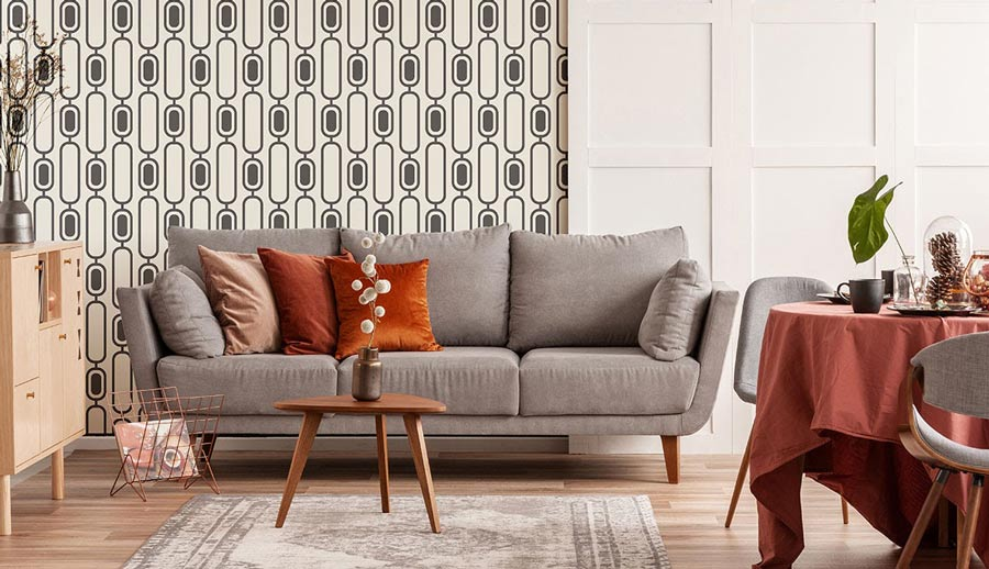 Living room with gray couch and vintage-inspired peel-and-stick-wallpaper