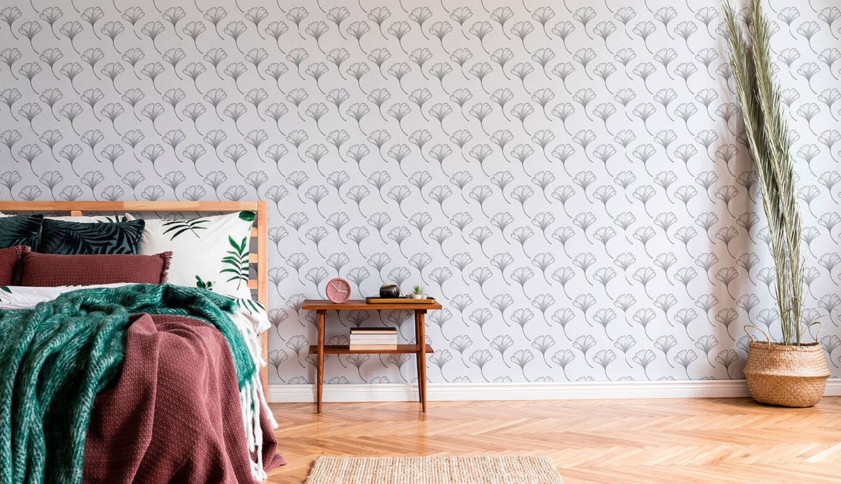 Gray line drawing wallpaper in a simple bedroom.