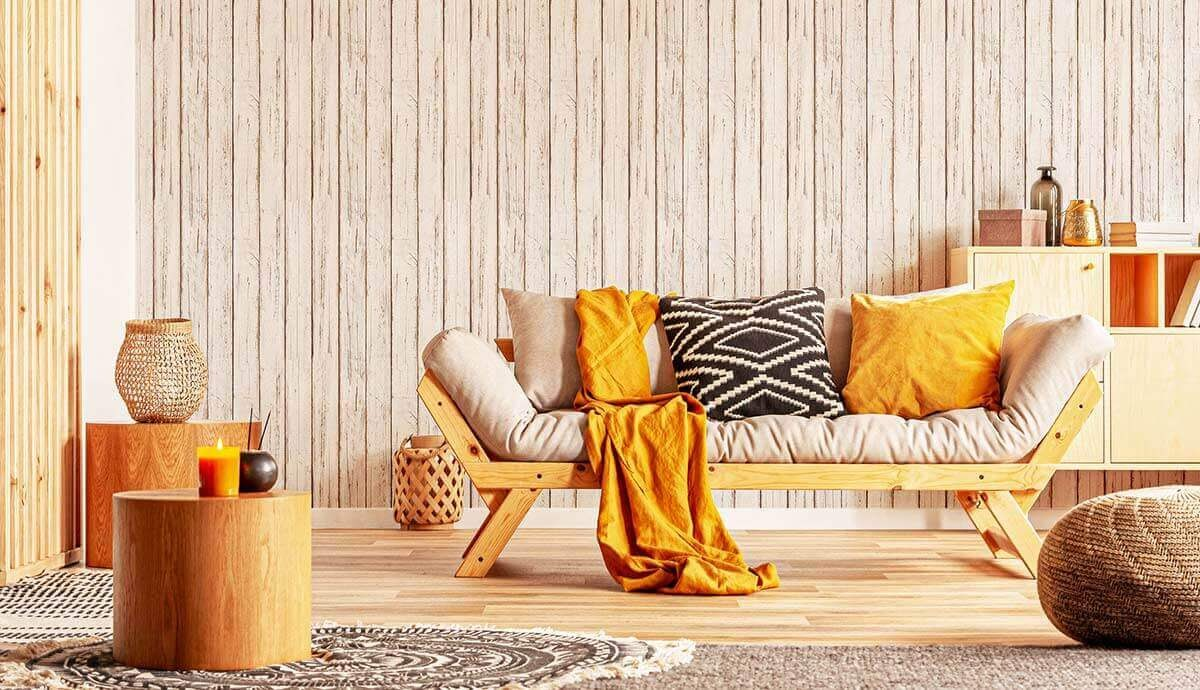 Timeless living room design with orange accents and beige wood wallpaper.