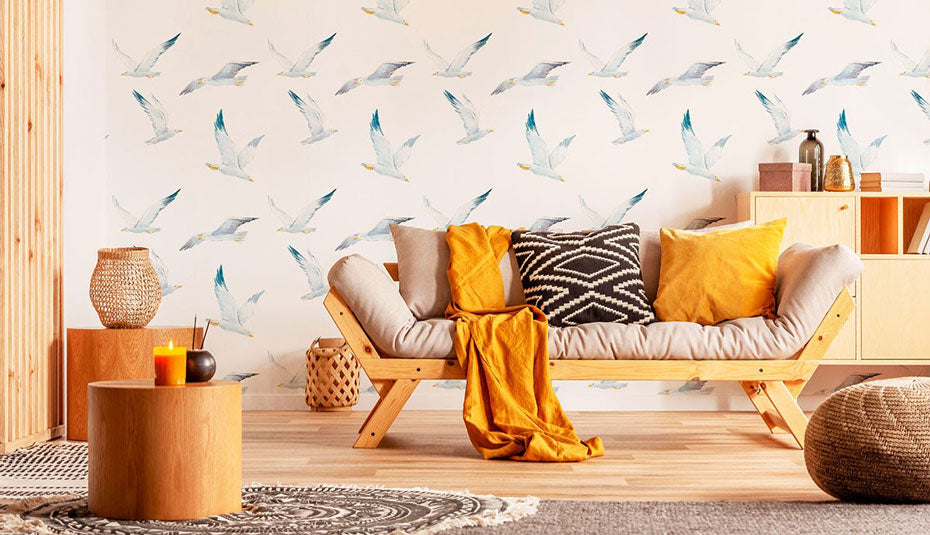 A living room with earth tone decor and bird removable wallpaper