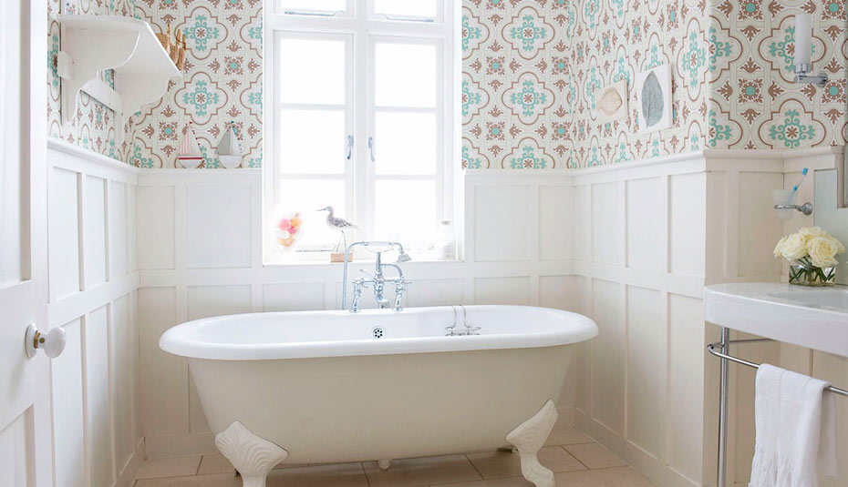 A bathroom decorated with Moroccan tile wallpaper in a rental.