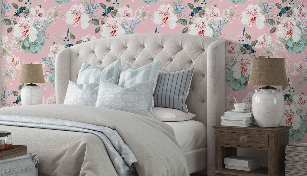 A pink floral romantic wall mural and a white bed.