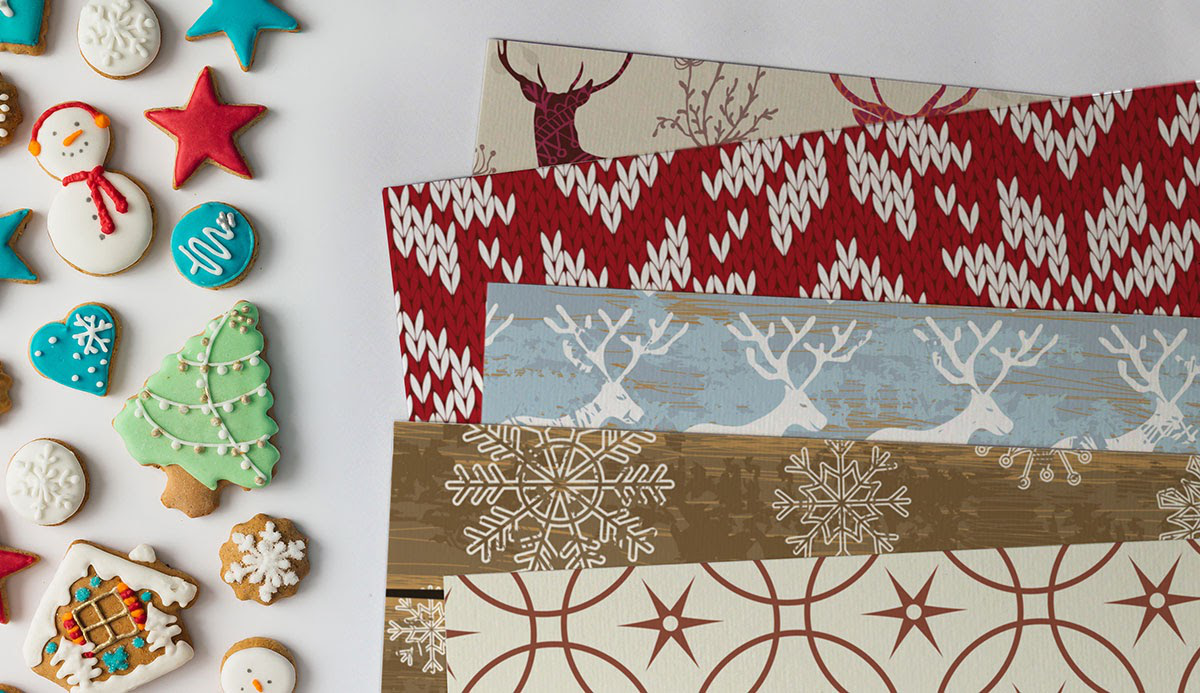A collection of salt dough ornaments and holiday-themed wallpaper.