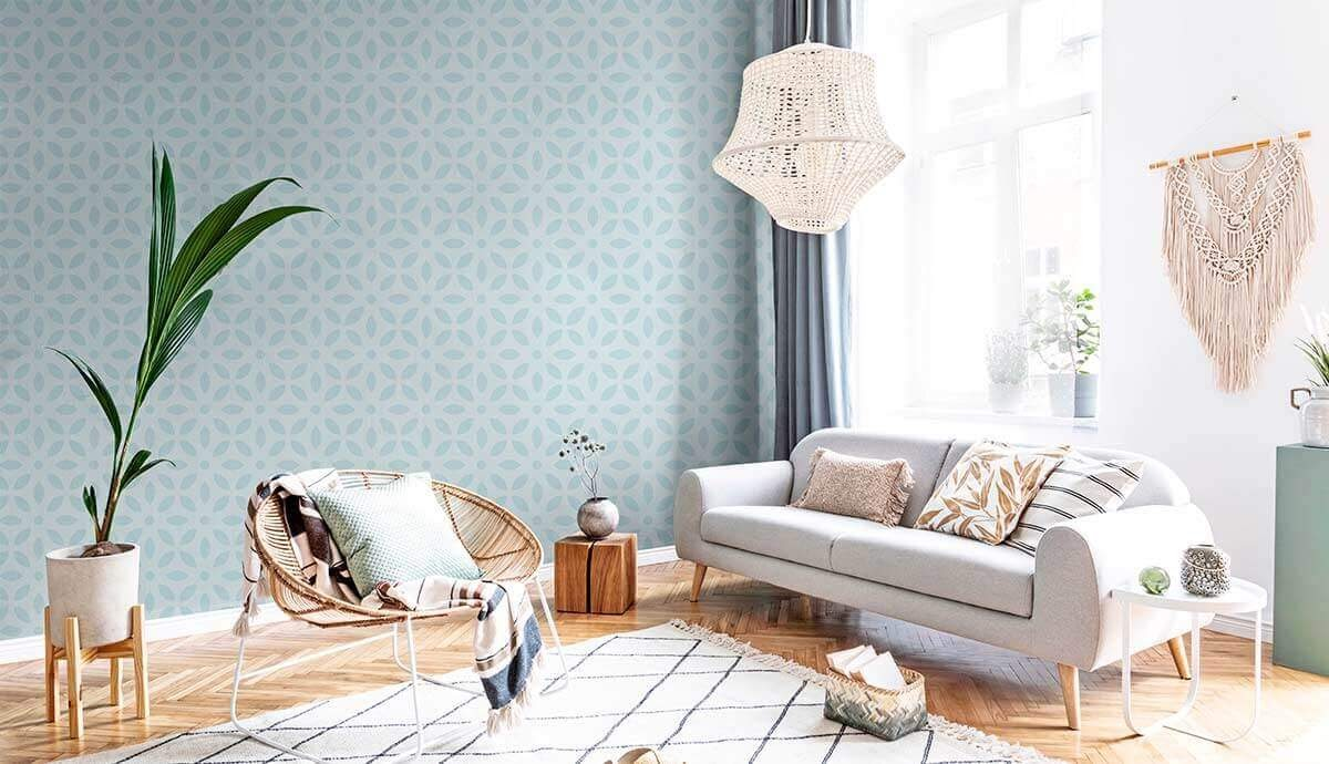 A timeless white living room with blue floral geometric wallpaper.