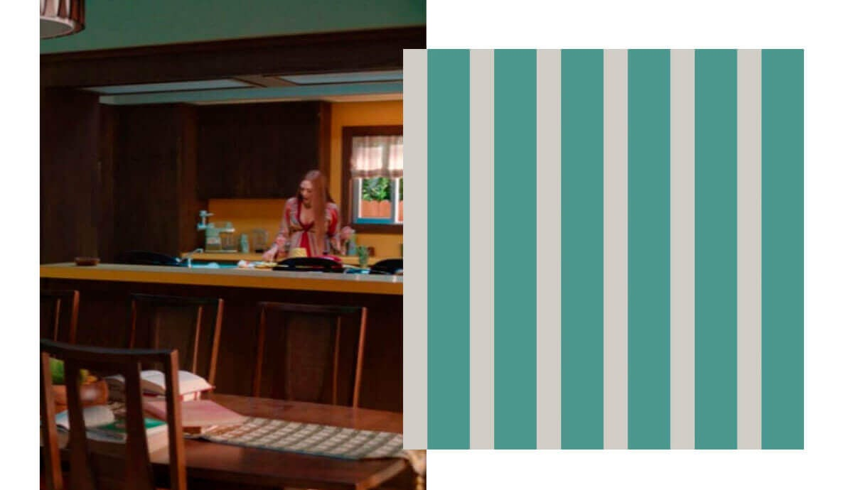 Wanda in kitchen with green and gray striped wallpaper.