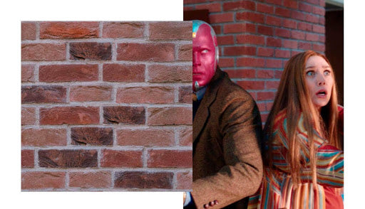 Wanda and Vision in front of red brick peel-and-stick wallpaper.