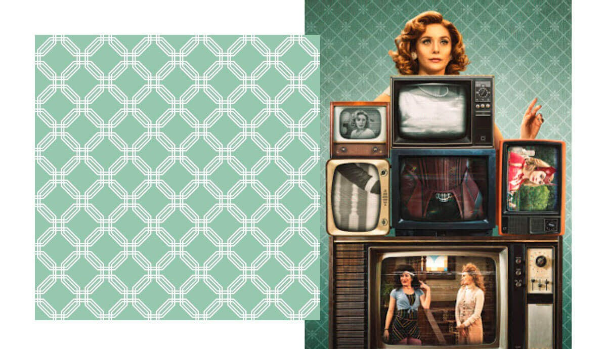 Wanda and TVs in front of white and pale blue geometric wallpaper.