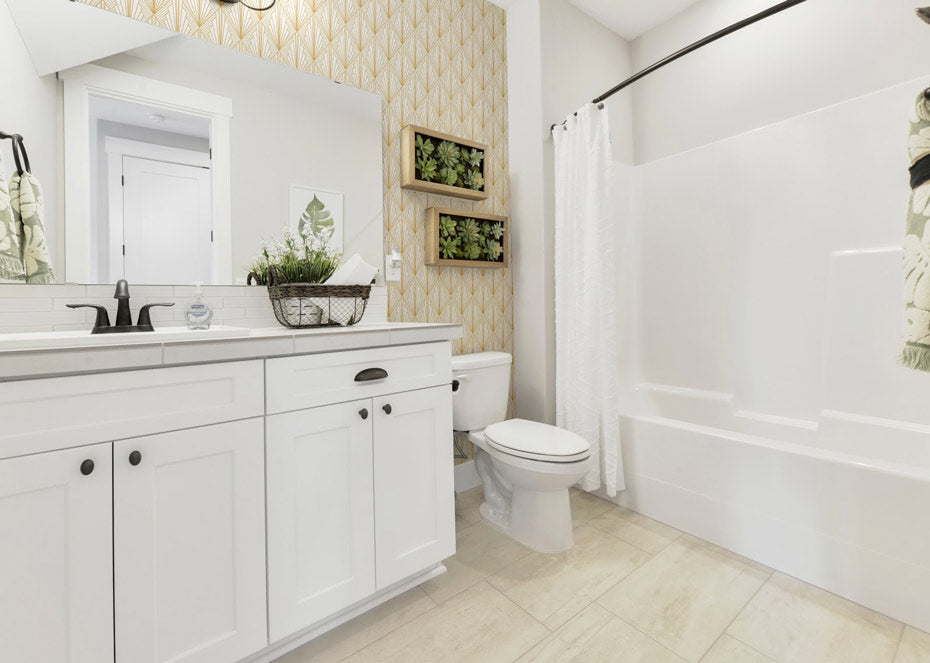 A white bathroom with white and gold wallpaper.