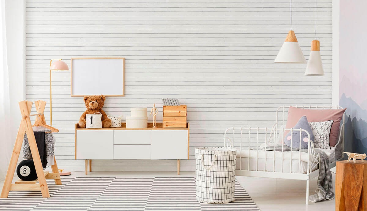 White children's room with kid-friendly decor and shiplap wallpaper.