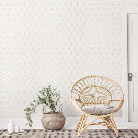 Sometimes, a few lines is all it takes to add a royal touch to your living space. This sophisticated peel and stick wallpaper is a perfect case in point. A fine gold lattice on a white background gives it a structured Art Deco vibe that lends itself to both vintage and contemporary homes. Whether it appears throughout the room or only as a statement wall, this damage-free removal wallpaper is guaranteed to impress!