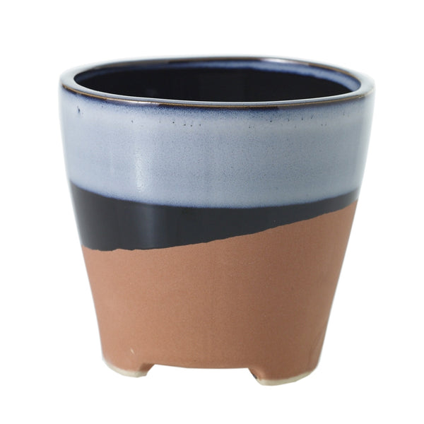 A smooth textured blue and black glazed stripe on top and a terracotta finish on bottom in size medium.