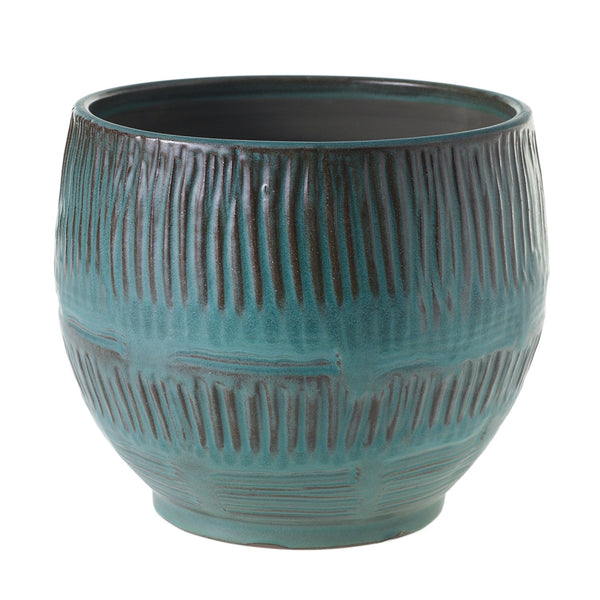 A beautiful textured blue and brown terracotta pot.