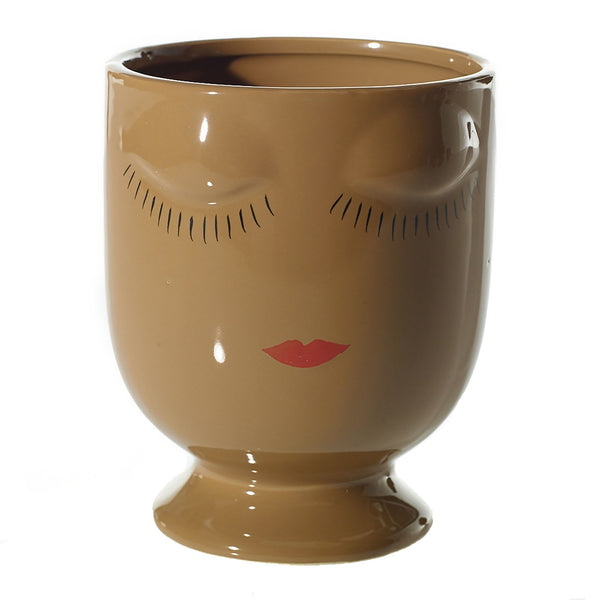Mini ceramic planters in a shiny, glazed finish with facial accents sculpted and painted on the front in colour brown.