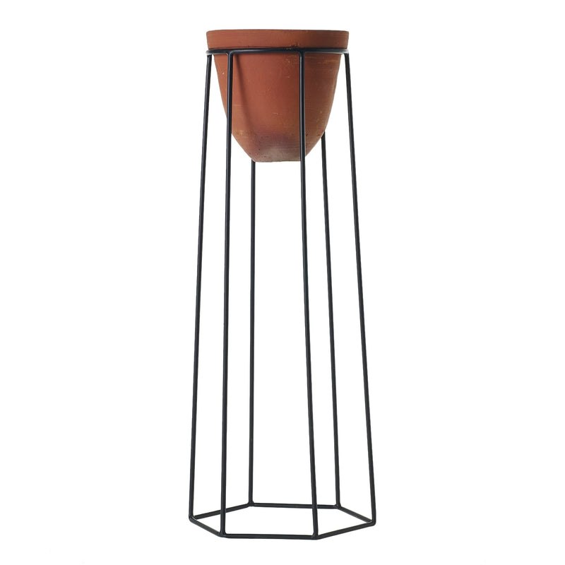 A plant stand with black metal geometric legs and a terracotta pot in size large.