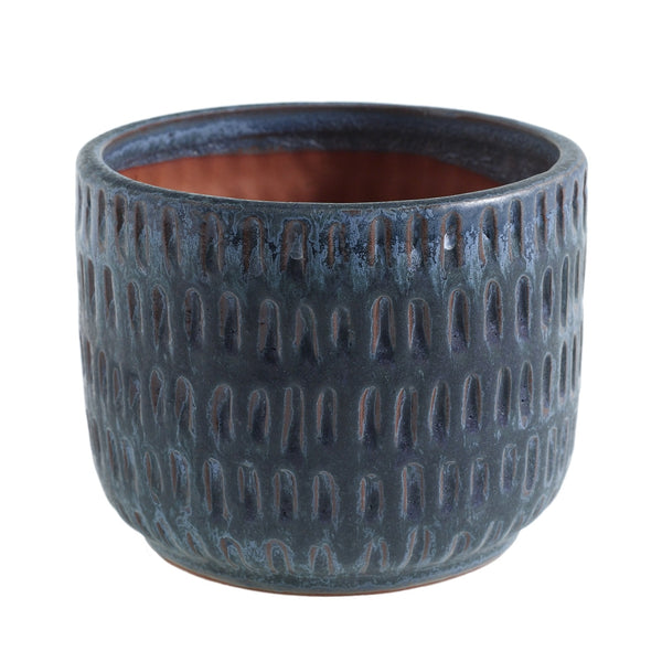 A beautiful textured navy blue ceramic pot.