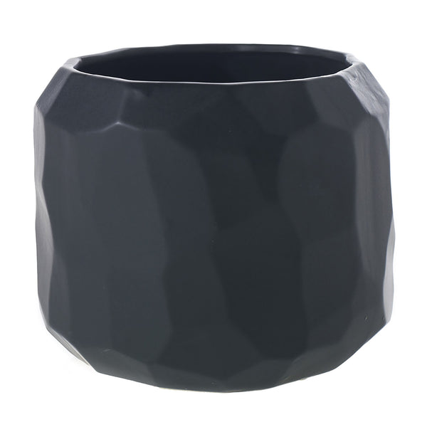 A faceted matte black pot in size small.