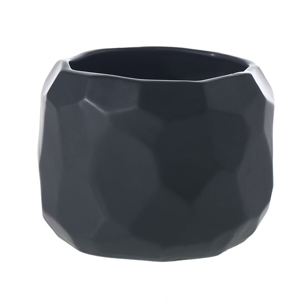 A faceted matte black pot in size medium.