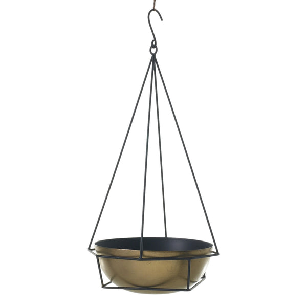 A hanging planter with black metal, geometric black frame and brushed gold bowl nestled within. In size medium.