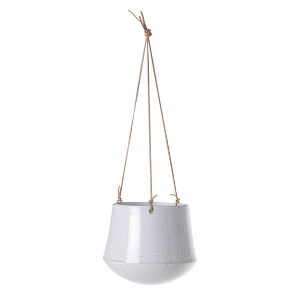Hanger with white speckled ceramic pot with light brown leather straps.