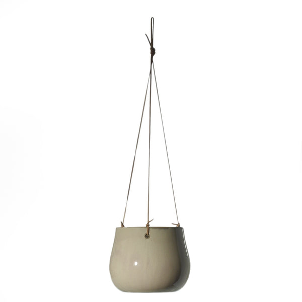 Glazed cream coloured ceramic hanging pot with genuine leather hangers in sized medium.