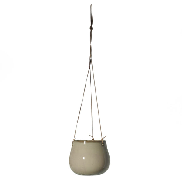 Glazed cream coloured ceramic hanging pot with genuine leather hangers in size small.