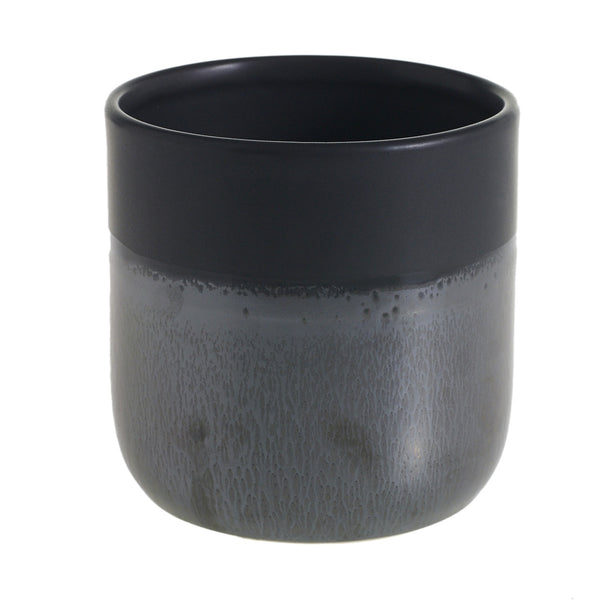 A matte black pot  with graphite grey glaze on the bottom. In size small.