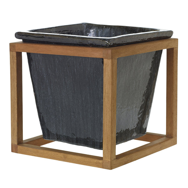 Plant Stand is made of a graphite black stoneware container sitting within a wooden oak frame in size medium.
