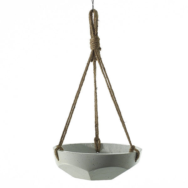 Hanging basket is a geometric concrete bowl painted white and suspended by a thick jute rope, tied in knots around the bowl.