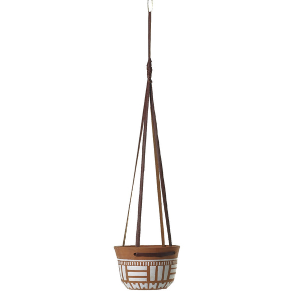 Hanging pot made from terracotta with white accents and adjustable leather straps for hanging.