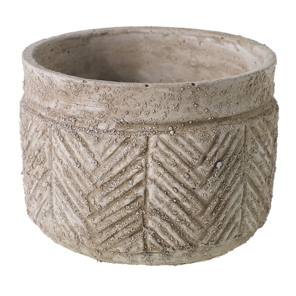 A light beige cement bowl container which features indented detailing.