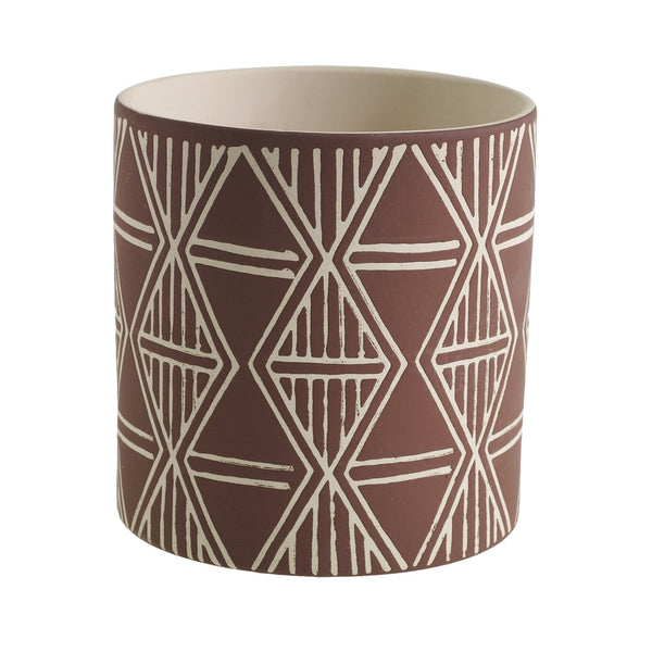 Mocha coloured planter with tribal patterns.