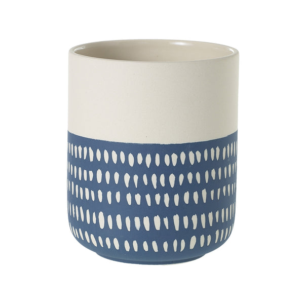 White and indigo stoneware planter accented with dotted patterns.