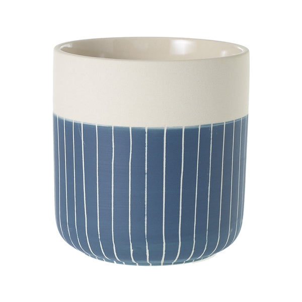 White and indigo stoneware planter accented with simple stripped patterns.