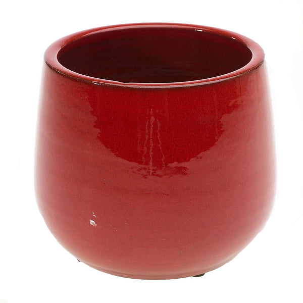 A beautiful red ceramic glazed container  in size small.