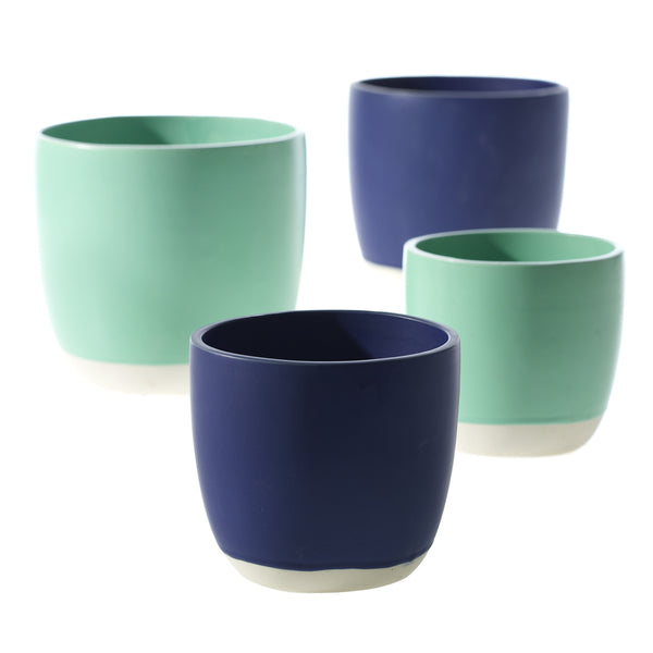 Four pots two with navy blue top, and two with turquoise top and a thin white stripe on the bottom.