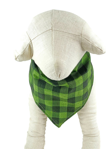 Green and black plaid dog bandana. Sometimes called tartan.