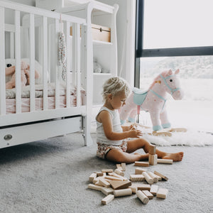 sustainable-toys-child-with-wooden-blocks