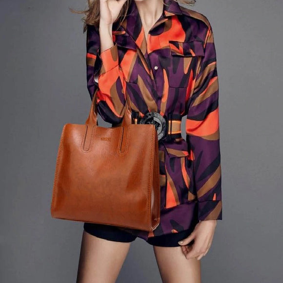 beautiful fashion model wearing a leather tote bag
