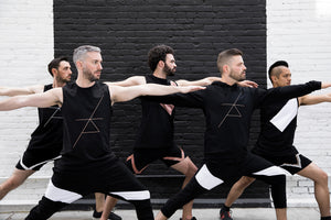 Stylish Men doing Yoga in Studio