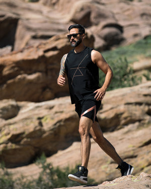 Man Jogging in Desert in Yoga Clothes