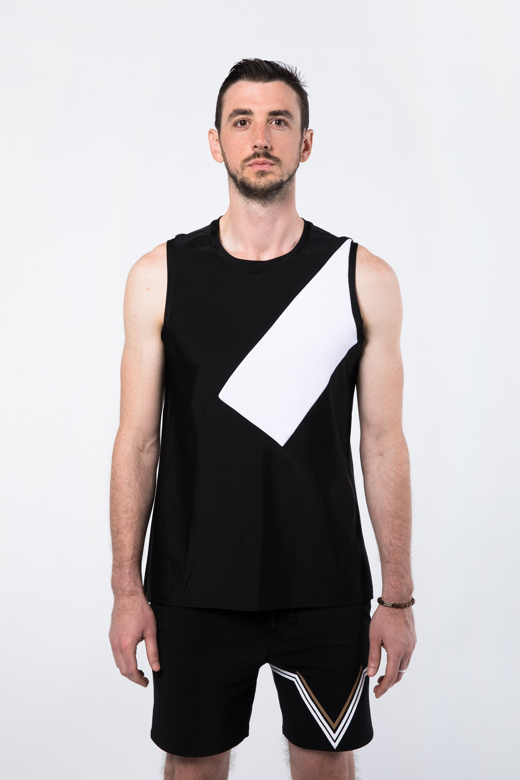 Man Standing in Black and White Yoga Shirt