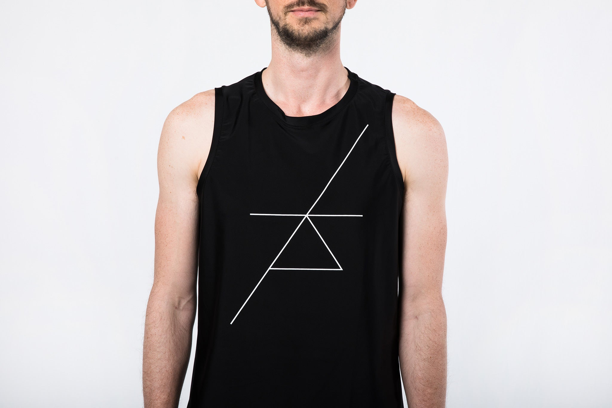 Man in Sleeveless Yoga Shirt by Coroa