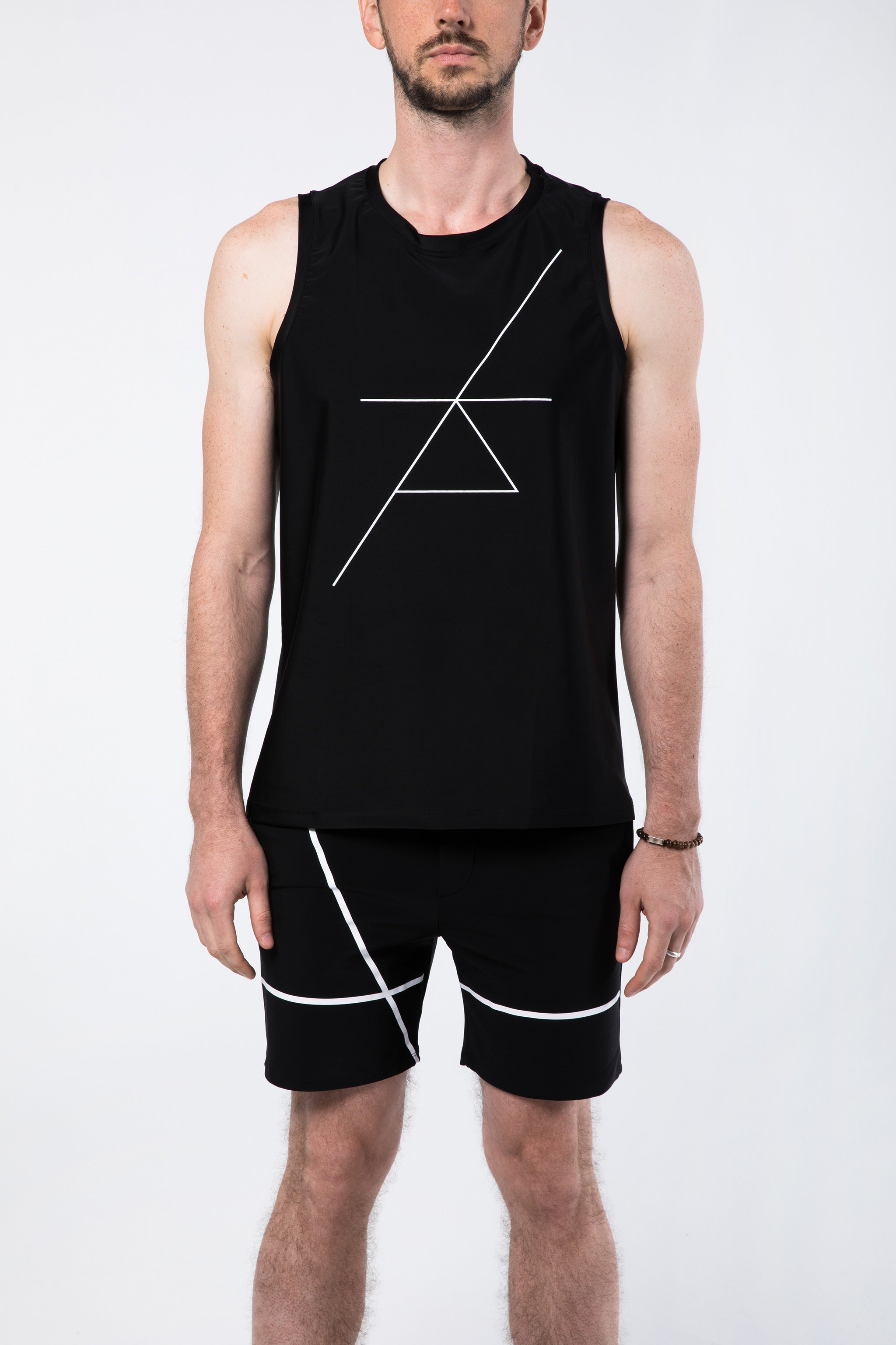Man in Sleeveless Yoga Shirt and Yoga Shorts for Men